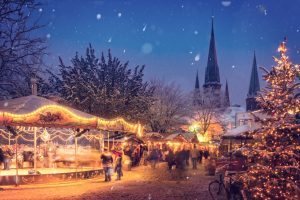 A snowy Christmas Book market in the British winter with lamp light market stalls with RK Alker Children's Author of Funny Kids Books