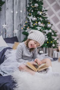 A Personalised Christmas Book Being Read by a Little Girl with RK Alker Children's Author of Funny Kids Books