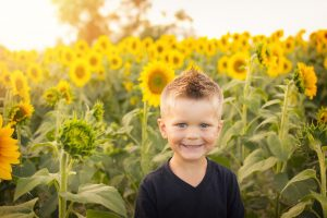 A child with sunflowers next to Kids Gardening RK Alker Kids' Author Chiliman Grower Food Evangelist Cook from Little Green Men Chili, Chorley, Lancashire, England, UK, Tel. 01772970190